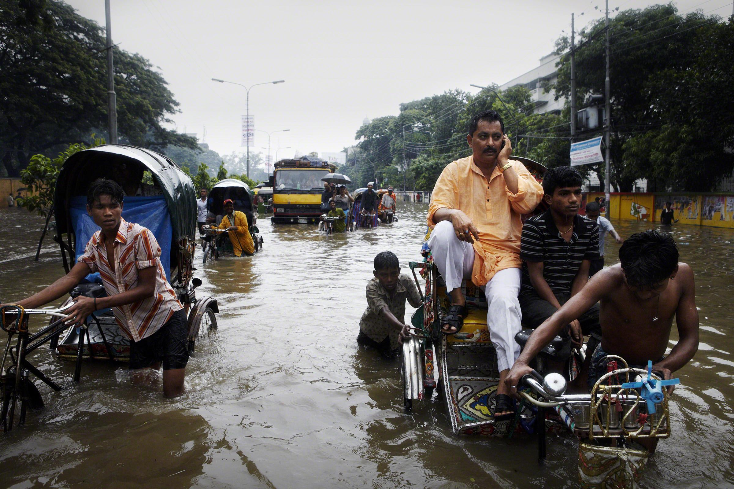 Arambagh, Dhaka, Bangladesh, 2009. After a night of heavy rain, Dhaka experienced widespread flooding around the city. Photo: Jonas Bendiksen
