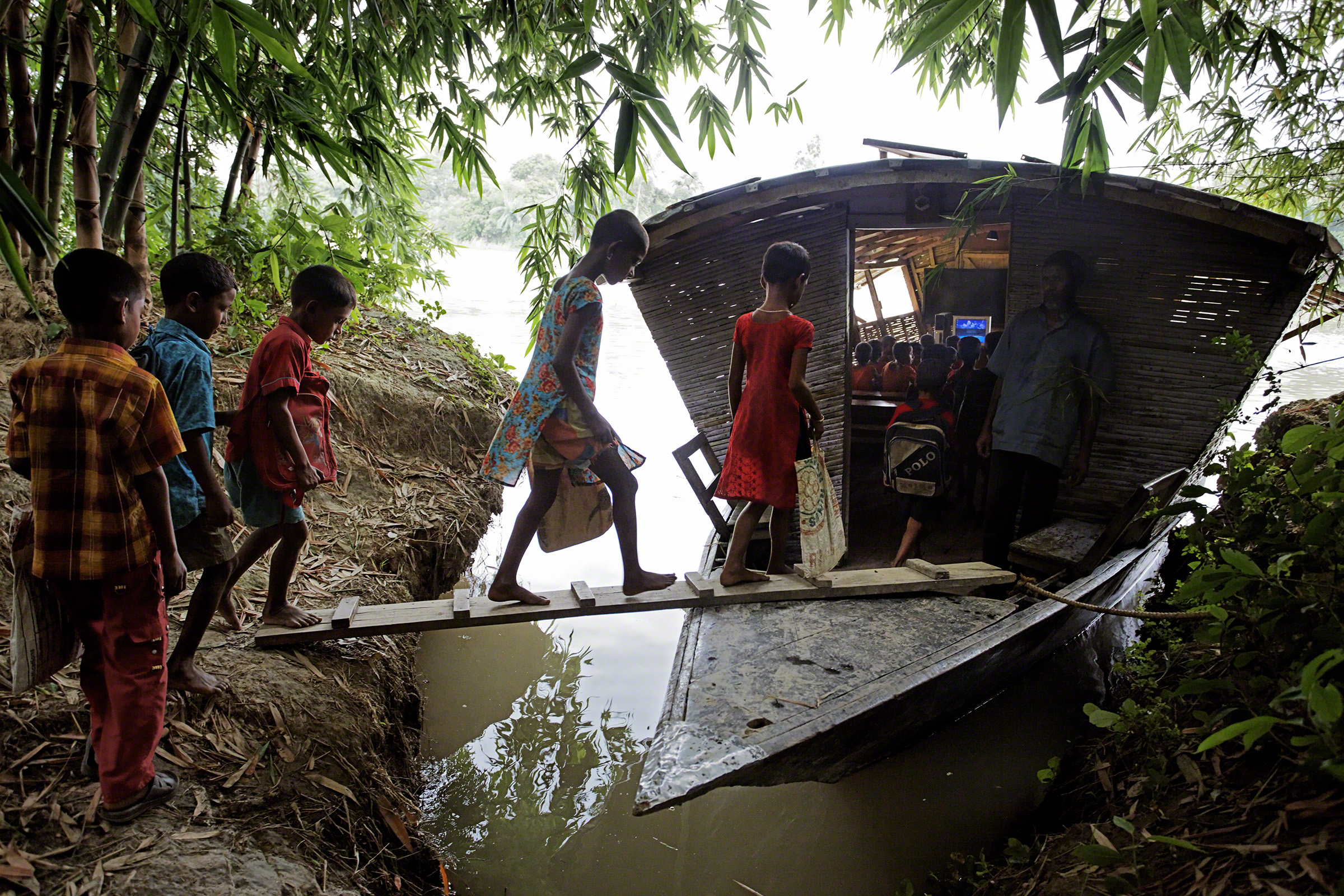 Pabna, Bangladesh, 2010. The nongovernmental organization Shidhulai Swanirvar Sangstha runs a fleet of more than 50 floating schools and libraries in an effort to provide basic education in a severely flood-prone area. Photo: Jonas Bendiksen
