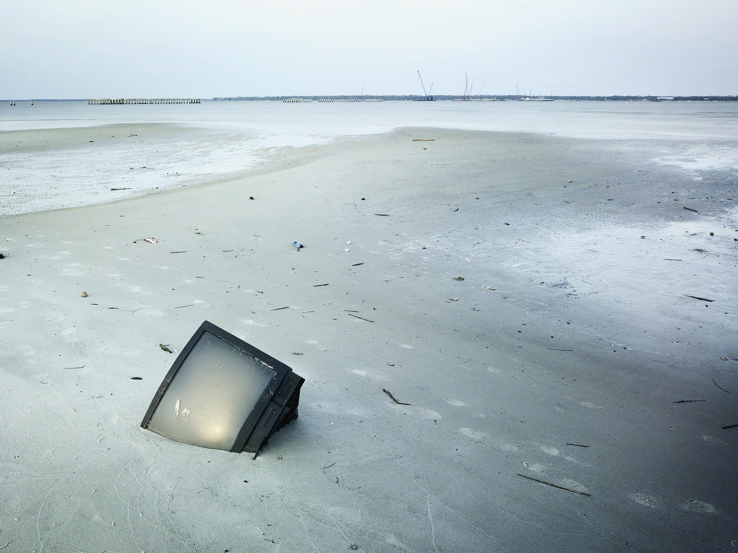 TV in the sand post Hurricane Katrina, Bay St. Louis, Mississippi, USA. Photo: Stephen Wilke