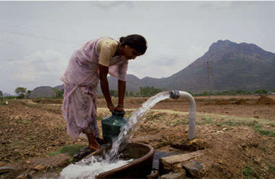 woman and water pump