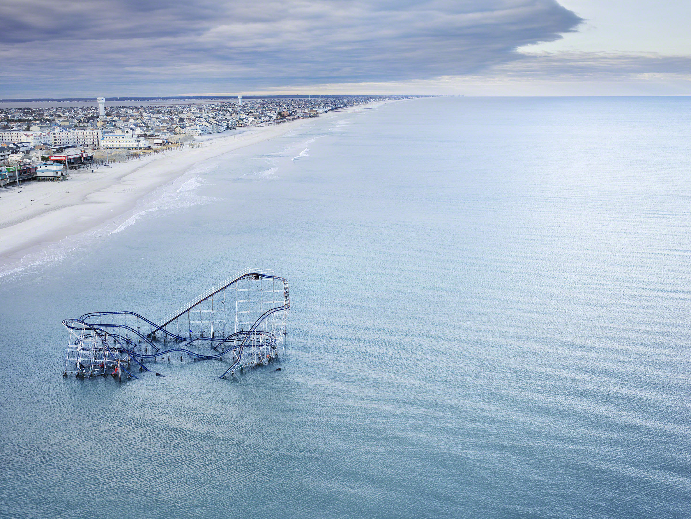 The roller coaster from the boardwalk in Seaside Heights, New Jersey, USA, partially submerged in the ocean after Hurricane Sandy. Photo: Stephen Wilkes courtesy of Peter Fetterman Gallery