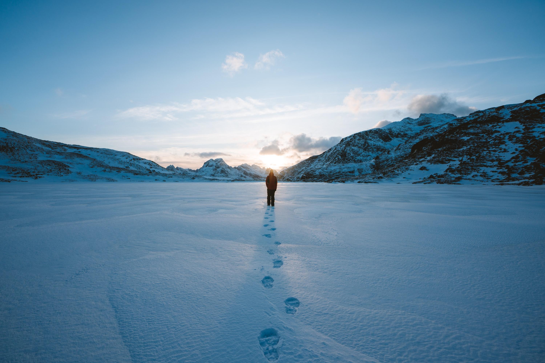 Person walking in a snowy landscape. Credit: S Migaj on Unsplash.