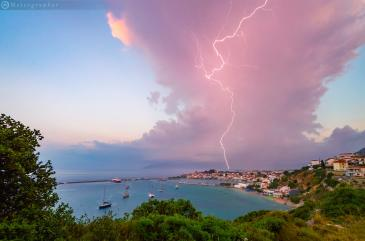 An isolated storm cell causing a lightning bolt above the seaside village of Pythagoreio, the Greek birthplace of ancient mathematician, Pythagoras. Photographer Manolis Thravalos