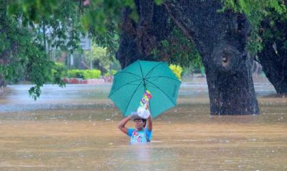 Residents of Korociri settlement cross through the flooded Nadi backroad in Fiji. Photo: Fiji Government