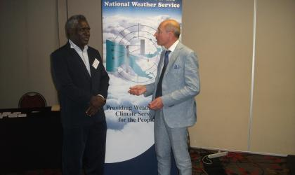 Mr Samuel Maiha, Director of PNG National Weather Service, and Professor Yuriy Kuleshov, science lead of CREWS-PNG from the Australian Bureau of Meteorology are discussing CREWS-PNG implementation strategy